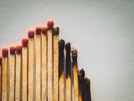Burned matchsticks. abstract concept of stock market crash Stock Photo