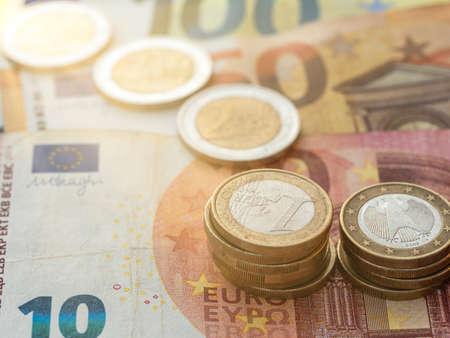 Close up view on euro coin stacks on euro bills. Standard-Bild