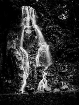 Black and White long exposure picture of Veu da Noiva waterfall, Sao Miguel island, Azores, Portugal. Standard-Bild