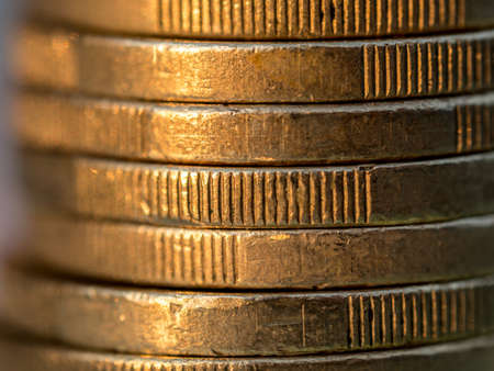 Close up view on euro coin stack on blue background