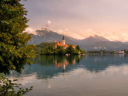 Lake Bled Slovenia. Beautiful mountain lake with small Pilgrimage Church. Most famous Slovenian lake and island Bled with Bled Castle in background.