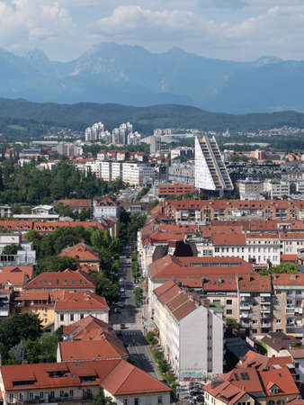 Ljubjana city view form castle hill with mountains in the background.