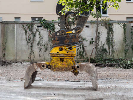 Bucket excavator closeup on deconstrucion site.