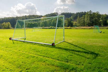 Soccer goal on a green soccer field. Standard-Bild