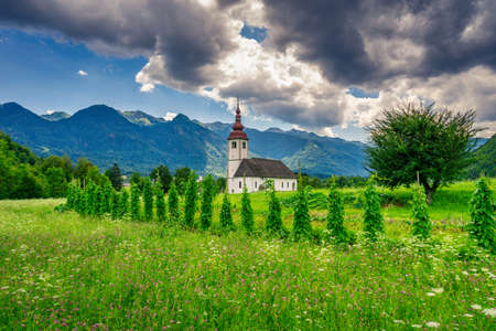 Church with agricultural sourrounding in Slovenia.