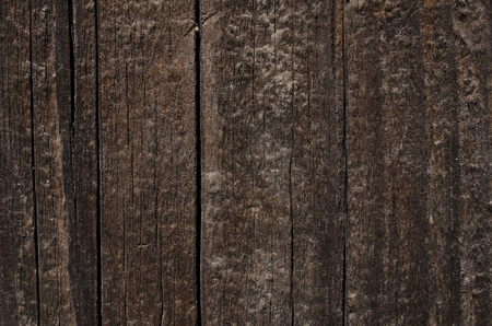 porosity: Dark vertical boards made of wood. Vertical lines of a wall from a natural tree Stock Photo