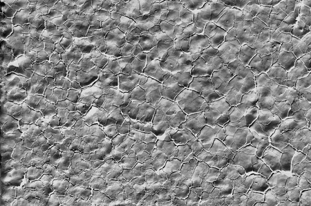porosity: The background dark gray color, the old paint on the stone