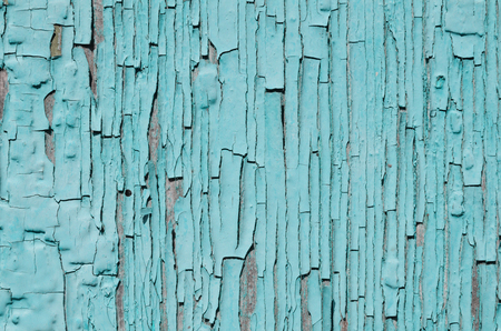 painted wood: Light blue paint peeling on the painted wood, texture, old paint Stock Photo
