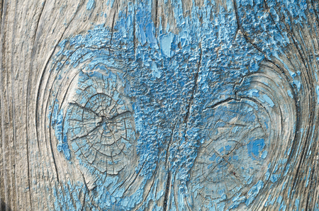 The texture is an old blue paint on the wood. The paint has disappeared, the wood is visible