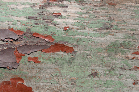 Texture, background, close-up, wood is painted with green, red and brown paint, the paint is old, almost disappeared Banco de Imagens