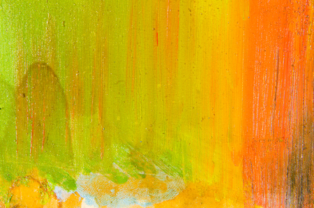 Orange, yellow and lemon paint on the canvas, vertical