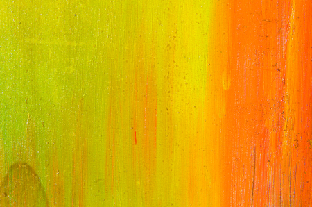 Beautiful, even smears of watercolor paint on canvas, orange, yellow and lemon color.