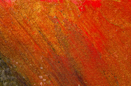 Orange and red smears on canvas, paint glows. Horizontal drawing