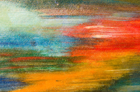 Beautiful horizontal smears of watercolor paint on canvas, red, blue and yellow. Stock Photo
