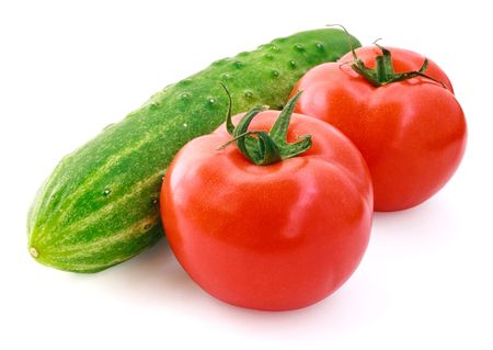 Fresh cucumber and tomatoes on white background photo