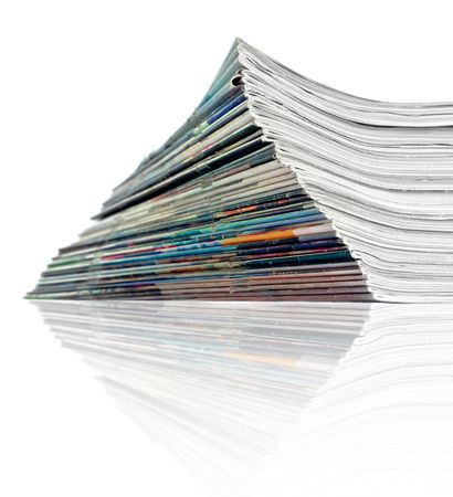 A large stack of magazines piled high photo