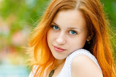 red head: Closeup portrait of a beautiful young woman Stock Photo