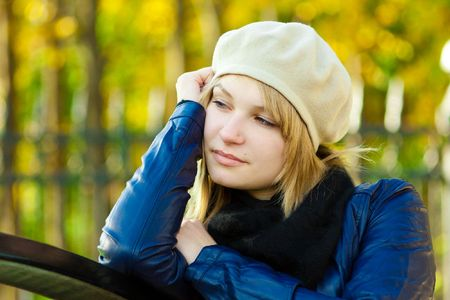 Closeup portrait of dreaming young woman in park photo