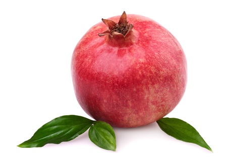 Juicy pomegranate and with leaves. Isolated on a white background