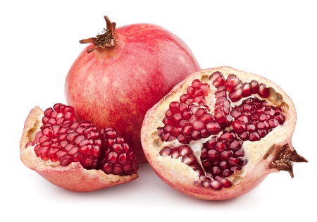 Juicy pomegranate and half. Isolated on a white background photo