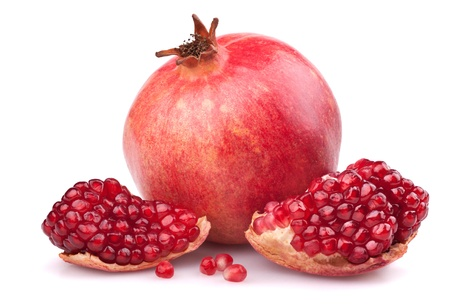 pomegranate: Juicy pomegranate and half. Isolated on a white background