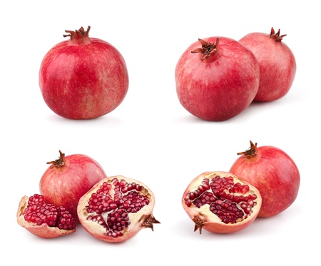 Set of juicy pomegranates and half. Isolated on a white background photo