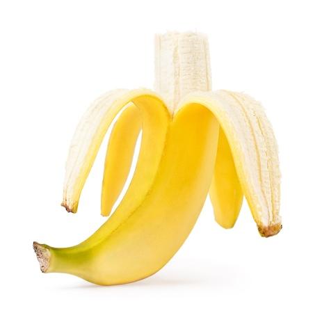 Half peeled banana isolated on a white background photo
