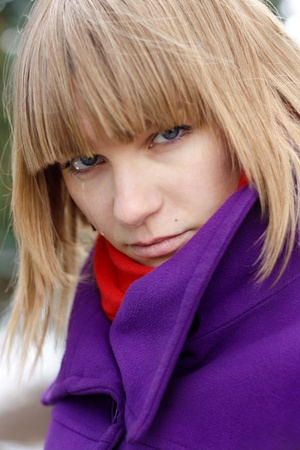 Closeup portrait of a crying young woman outdoors photo