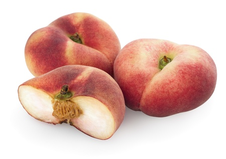 Chinese flat peaches with half isolated on a white photo