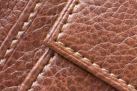 hem: Closeup of a brown leather texture background
