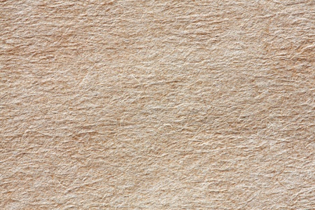 Closeup of rough recycled paper texture background photo