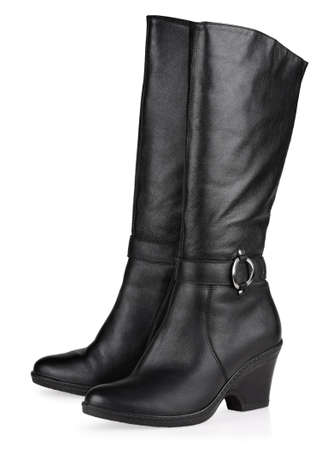 Black female fashionable leather boots isolated on white background photo