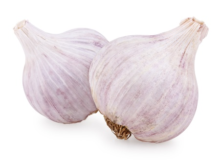 Closeup of two purple garlic isolated on white background photo