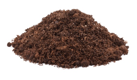 Pile of soil for plant isolated on white background photo