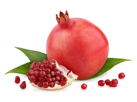 Ripe pomegranate fruit with leaves and seeds isolated on white background photo