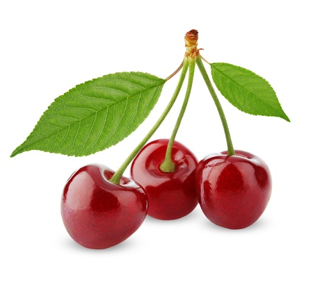 Three sweet cherries with leaves isolated on white background Stock Photo
