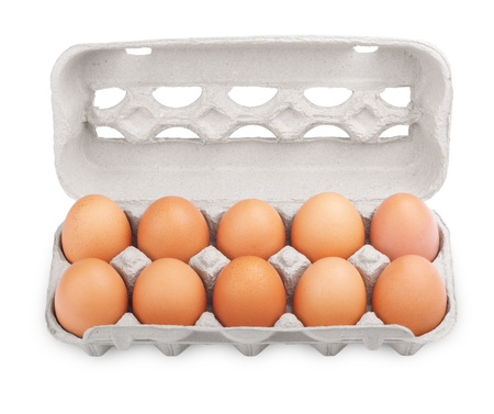 Ten brown eggs in a carton package isolated on white photo