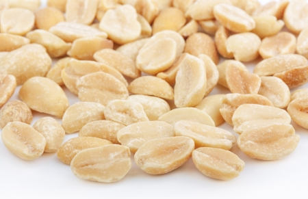 Heap of salted peanuts on white background photo