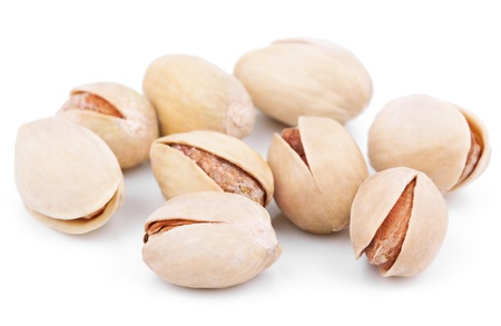Closeup of salted pistachios isolated on white background photo