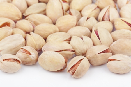 Closeup of salted pistachios on white background photo