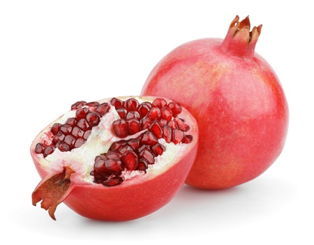 Ripe pomegranate fruit with half isolated on white background photo