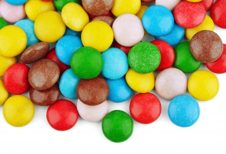 Closeup of colorful chocolate candies on white photo