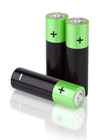 Closeup of three AA batteries isolated on white background photo