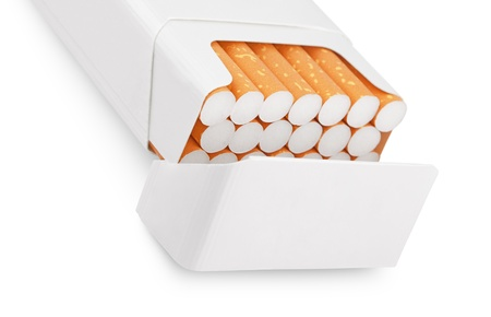 Open pack of cigarettes isolated on white photo