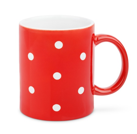 Red mug polka dot isolated on white with clipping path photo