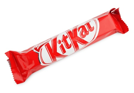 nestle: Closeup of Kit Kat candy chocolat bar made by Nestle isolated on white background