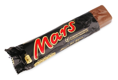 Closeup of unwrapped Mars candy chocolat bar made by Mars Inc. isolated on white background with clipping path