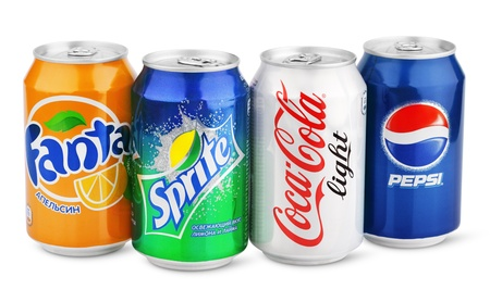 Group of various brands of soda drinks in aluminum cans isolated on white with clipping path. Brands included in this group are Coca Cola, Pepsi, Sprite, Fanta.