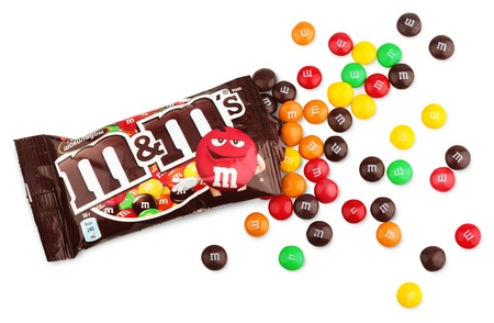 unwrapped: Closeup of unwrapped M&Ms milk chocolate candies made by Mars Inc. isolated on white background with clipping path