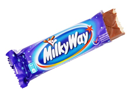 candy bar: Closeup of unwrapped Milky Way candy chocolate bar made by Mars Inc. isolated on white background with clipping path